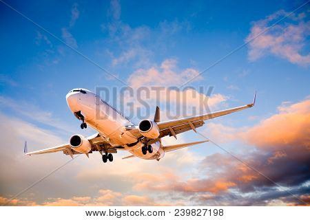 Aeroplane Pr Airplane Or Aircraft Flying In Beautiful Sunset Sky.