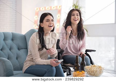 Best Sisters. Active Sister And Disabled Woman Regarding Film And Laughing