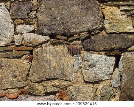 Detail Of An Old Stone Wall Of A Rural Building, Texture Of Natural Stone, Close-up