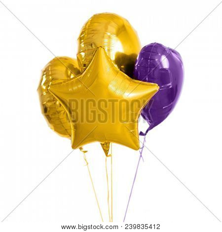 holidays, birthday party and decoration concept - close up of inflated helium balloons over white background
