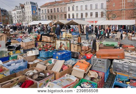 Brussels, Belgium - Apr 3: Square With Flea Market And Many Old Art, Bargains And Antique Stuff In M