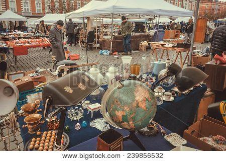 Brussels, Belgium - Apr 3: Street Traders On Flea Market With Old Art, Bargains And Antique Stuff, V