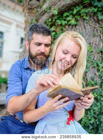 Couple In Love, Teacher And Student Reading, Nature Background, Defocused. Girl With Happy Face Hold