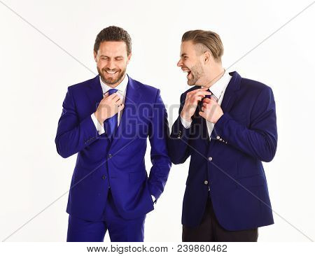 Stylish Businessmen Concept. Business Partners Correct Ties By Hands. Businessmen Preparing Outfit A