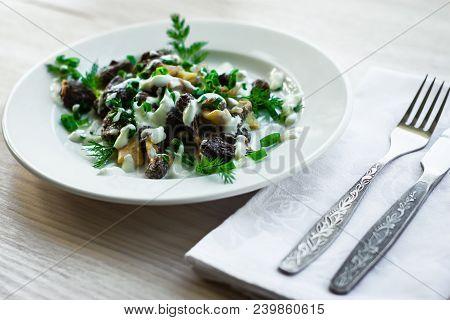 Mushrooms morel with sour cream sauce. Morchella esculenta. Exquisite dish. poster