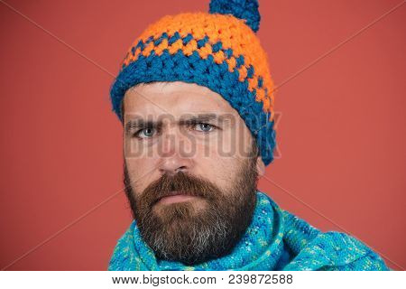 Bearded Macho In Autumn-winter Clothes. Serious Bearded Man With Long Beard Dressed In Knitted Hat A