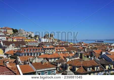 Beautiful View Of The City Of Lisbon, With The Skyline And The Lisbon Cathedral And The Tagus River