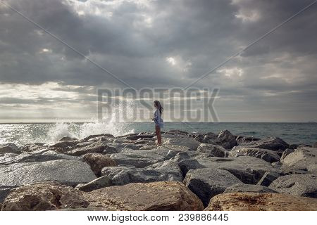 Summer Portrait Of Young Woman Over Stormy Landscape. Summer Portrait Of Woman Standing On Sea Shore