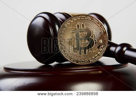 Auction Gavel And Bitcoin Cryptocurrency Money On A Wooden Desk, Close-up. Law Gavel And Golden Bitc