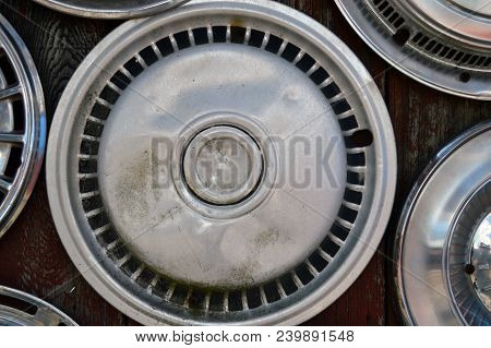Straight Shot Of Car Tire Hubcap Wall