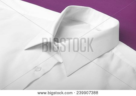 Fold White Long Sleeves Shirt. Studio Shot
