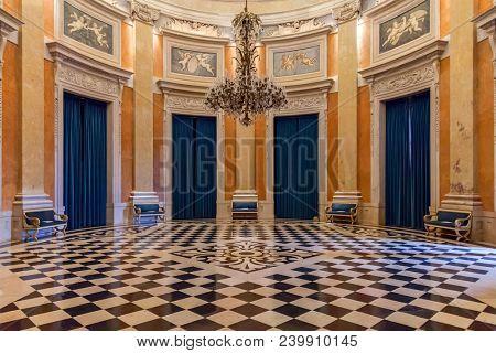 Lisbon, Portugal - June 10, 2013: Ambassador Hall of the Noble Floor in Ajuda National Palace or Palacio Nacional da Ajuda with checkered freemason floor. 19th century neoclassical Royal palace.