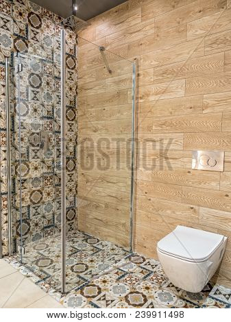 Stylish bathroom with shower cabin and toilet bowl