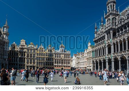Brussels, Belgium - May 5, 2018 : People Visiting The Grand Place (grand Square) Is The Central Squa