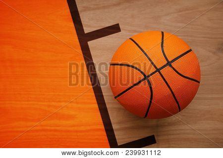 Basketball Ball Laying On Hardwood Court Floor, Top View