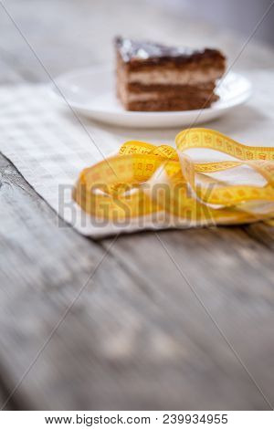 Delicious Food. Centimeter Tape Lying Near The Delicious Piece Of Cake