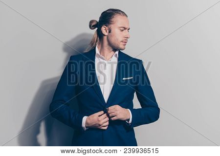 Side View Face Portrait Of Stylish, Caucasion Man Correcting Buttons On His Blue Jacket, Turned Face