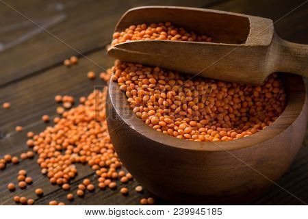 Organic Red Lentils In Bowl On Wooden Table