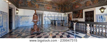 Lisbon, Portugal - September 9, 2013: Sala da Portaria, the Baroque Entrance Hall on Mosteiro de Sao Vicente de Fora Monastery. Lectern and Frescoes or frescos on ceiling. Blue tiles azulejos on walls