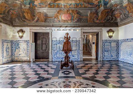 Lisbon, Portugal - September 9, 2013: Sala da Portaria, the Baroque Entrance Hall on the Mosteiro de Sao Vicente de Fora Monastery. Lectern and Frescoes or frescos on ceiling. Blue tiles aka azulejos