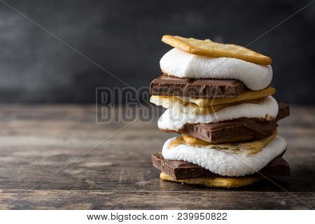 Homemade Smores On Wooden Table. Typical American Food. Copyspace