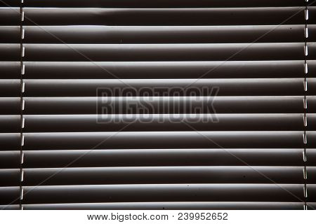 Blinds In A Home Catching The Sunlight,metal Shutter Window Background.blinds. Window Blind. Blind B