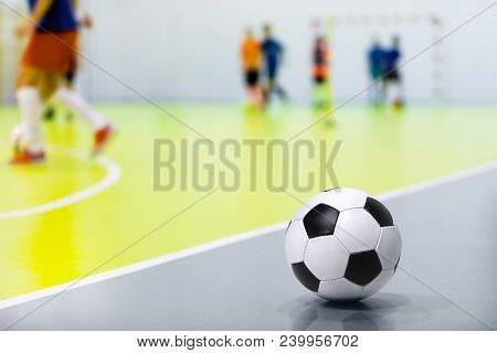 Indoor Soccer Futsal Ball. Indoor Soccer Match In The Background. Indoor Soccer Sports Hall. Sports