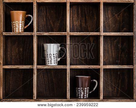 Ceramic Coffee Mugs On Handmade Wooden Rustic Wall Shelf