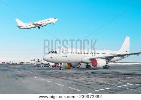 Passenger Aircraft Row, Airplane Parked On Service Before Departure At The Airport. One Aircraft Tak