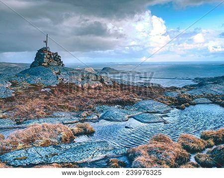 Mountain Peak Linesfjellet  (230 M), Linesoya Island, Norway. Stone Pyramid On Mountain Summit, Swam