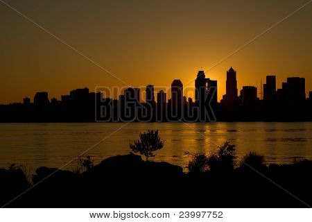 Sunrise over Seattle Washington Skyline Along Puget Sound from Alki Beach poster