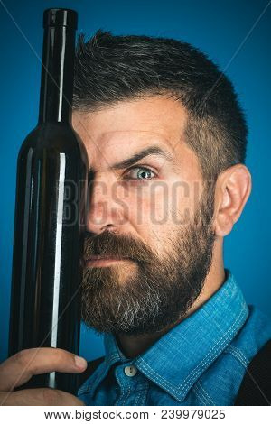 Bearded Man, Handsome Man With Beard And Moustache On Serious Face Holding Glass Wine Bottle Covers