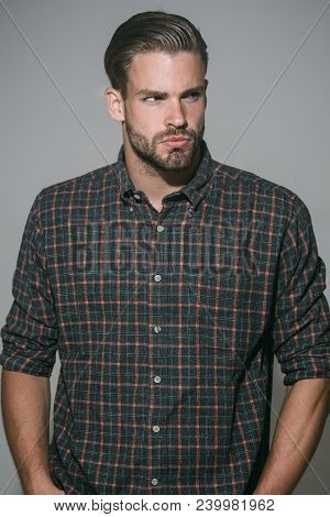 Handsome Bearded Man. Serious Man With Beard In Checkered Shirt Looks Aside. Brutal Caucasian Hipste