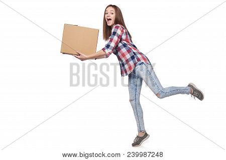 Delivery concept. Full length excited woman running hurrying carrying cardboard box, isolated on white background poster