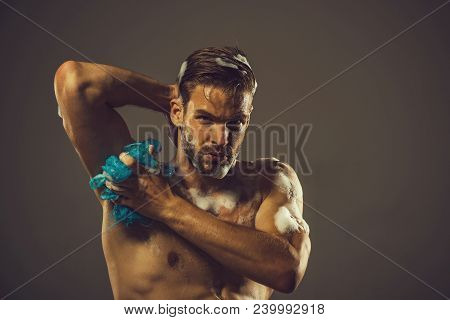 Muscular Man With Beard Posing In Bathroom. Muscular Sexy Macho Showering After Workout. Handsome Mu