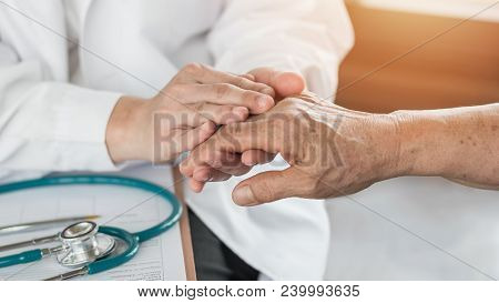 Elderly Senior Adult Patient (older Person) Having Geriatric Doctor (geriatrician) Consulting And Di