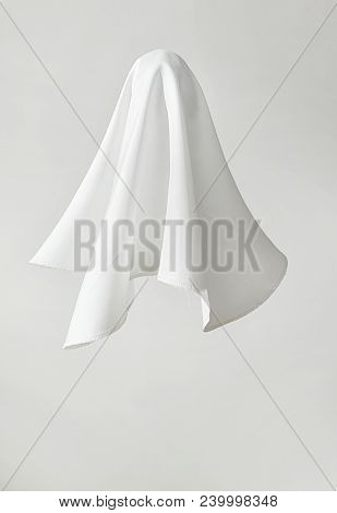 White Fabric In Shape A Ghost On White Background