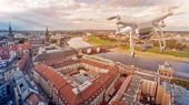 multicopter drone over the old city center of Dresden, Germany  poster