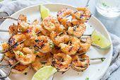 Grilled shrimp skewers with garlic honey marinade. Seafood, shellfish. poster