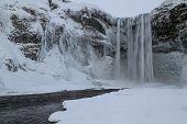 Skogafoss waterfall frozen, a treasure in Iceland poster