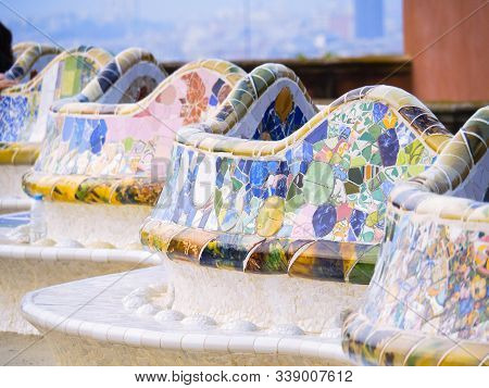 Barcelona, Spain - August 2019: Medium View On Bench Covered With Multicolour Mosaic. Park Guell In
