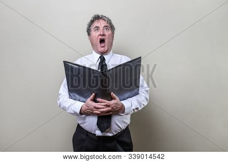 Older man singing in a choir