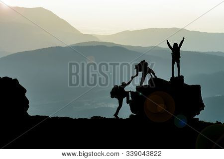 Adventurous Three Climbers Peak Achievements And Spectacular Mystical Landscapes;climbers Supporting