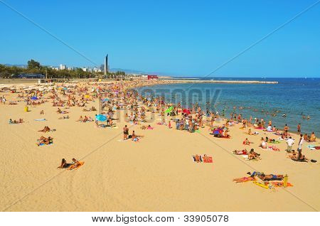 BARCELONA, SPAIN - AUGUST 16: La Nova Icaria Beach on August 16, 2011 in Barcelona, Spain. This beach, arised with the urban redevelopment on the occasion of the 1992 Olympic Games, is 400 meters long