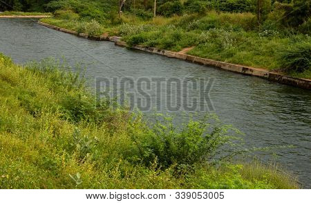 View Of Water Flowing In A Canal For Irrigation. Water Released From Mettur Dam For Irrigation And D