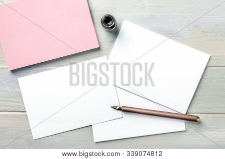 Stationery Mock-up With An Ink Bottle And A Nib Pen. Blank Greeting Cards Or Invitations, Shot From