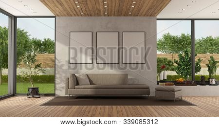 Minimalist Living Room With Garden On Background And Modern Sofa Against Concrete Wall - 3d Renderin