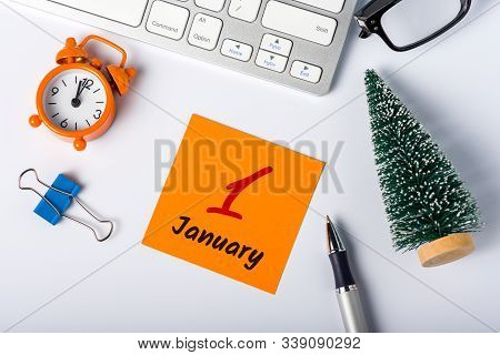 January 1st. Day 1 Of Month, Calendar On Office Workplace Background. Winter Time, New Year 2020