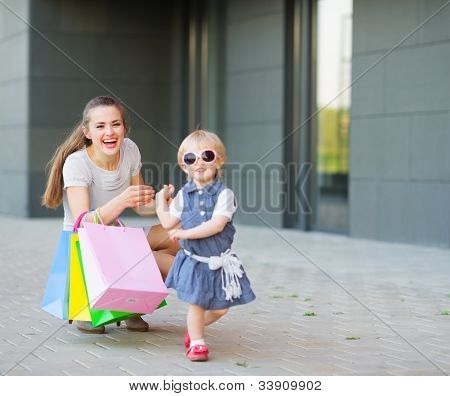 Fashion-monger baby on shopping with mom wear new glasses poster