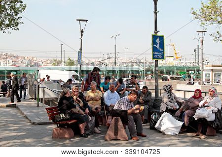 Some Local People Sitting In City Park On The Hasty European Side Of The City. Istanbul Turkey 05/13